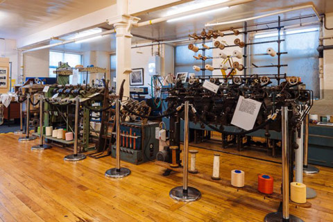 interior of Paisley Thread Mill Museum showing looms and yarn