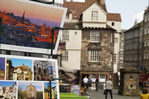 Postcards for sale in a stand outside John Knox House in Edinburgh
