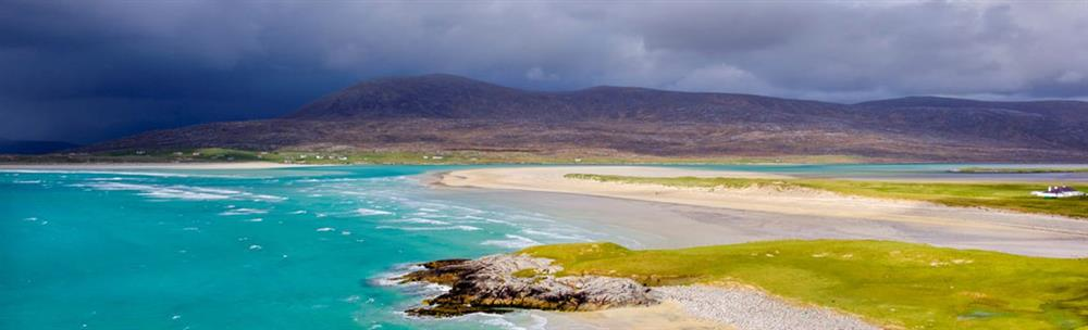 Bright turquoise sea and white beach with Machair