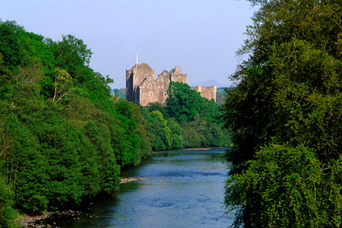 Doune Castle seen from the tree-lined banks of the River Teith