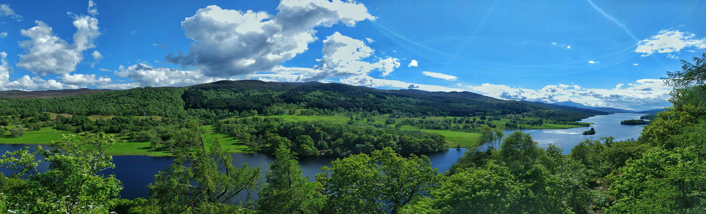Looking down at Loch Tummel from the tree-line banks