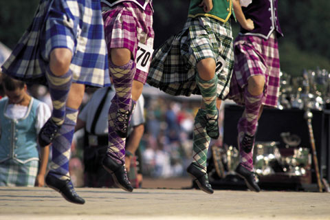Four Scottish country dancers competing in Highland Games