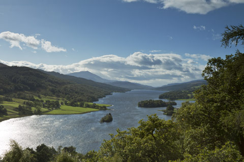 Queens View - wide river Tummel with forest on either side and a view to Schiehallion in the background