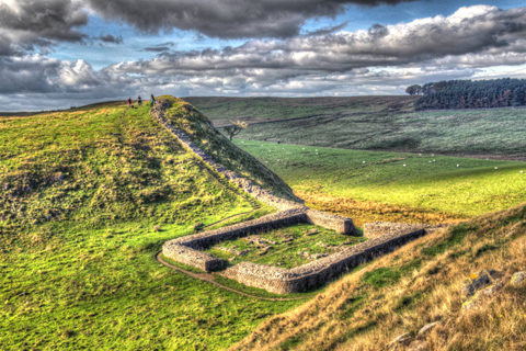 Walkers look down on the ruins of Nick Castle and Hadrian's Wall