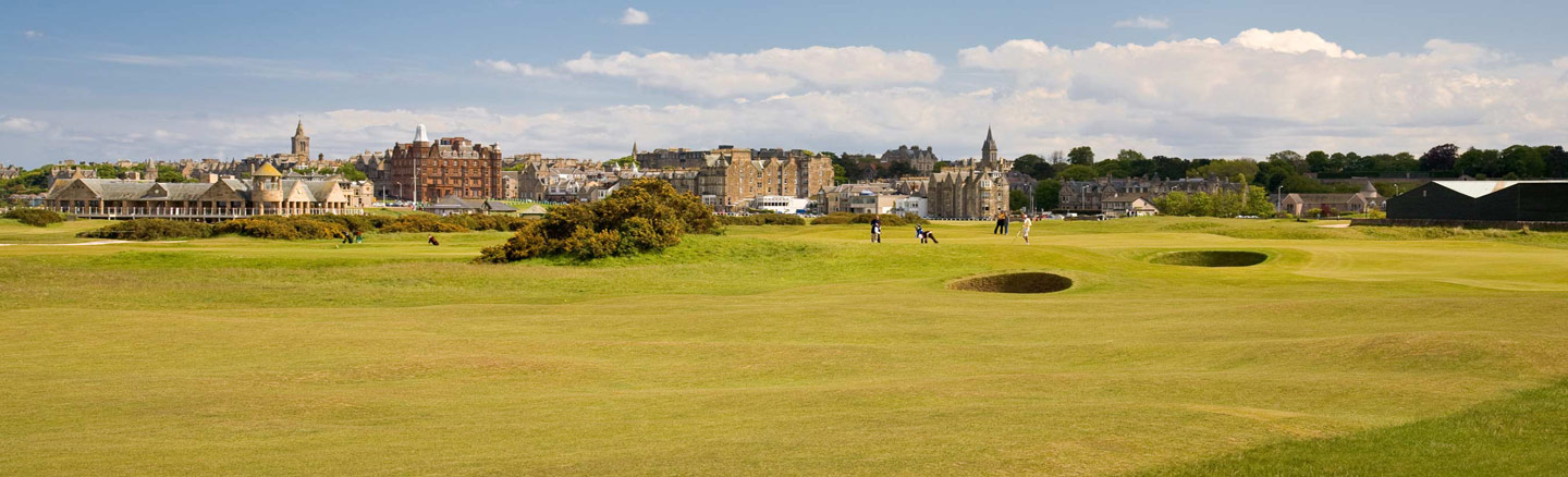 St Andrews seen from across the grass fairways and bunkers of the Old Course