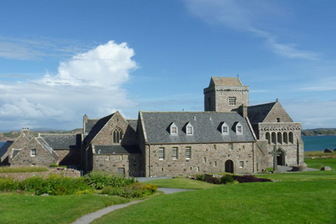 grey stone Abbey and nunnery on the isle of Iona on bright day